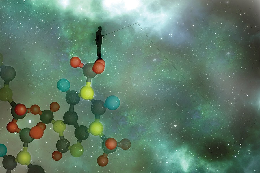 An abstract illustration shows a man fishing in the universe while standing on atoms
