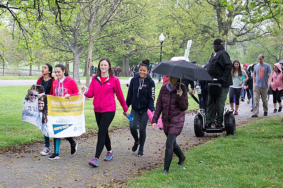 Nearly 100 people walk in the rain in the 2017 JHU Out of Darkness campus walk