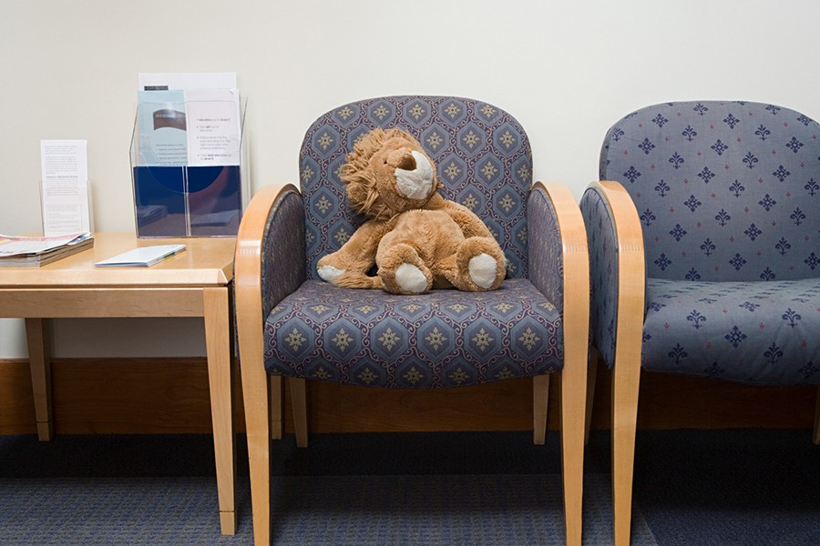 A stuffed lion in a doctor's office waiting room