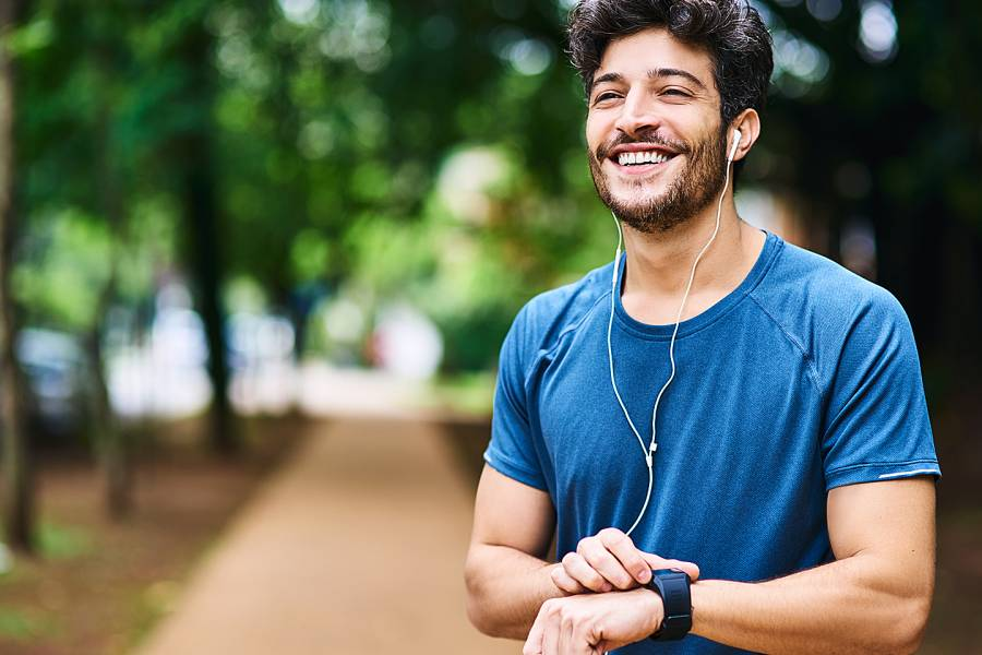 Man checking his fitness tracker outdoors