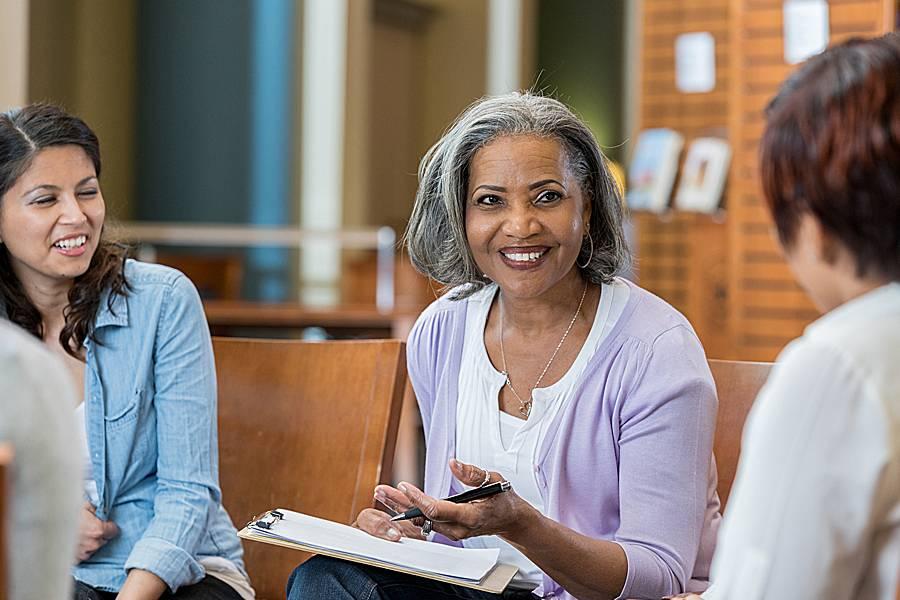 Female professor speaking in a casual setting