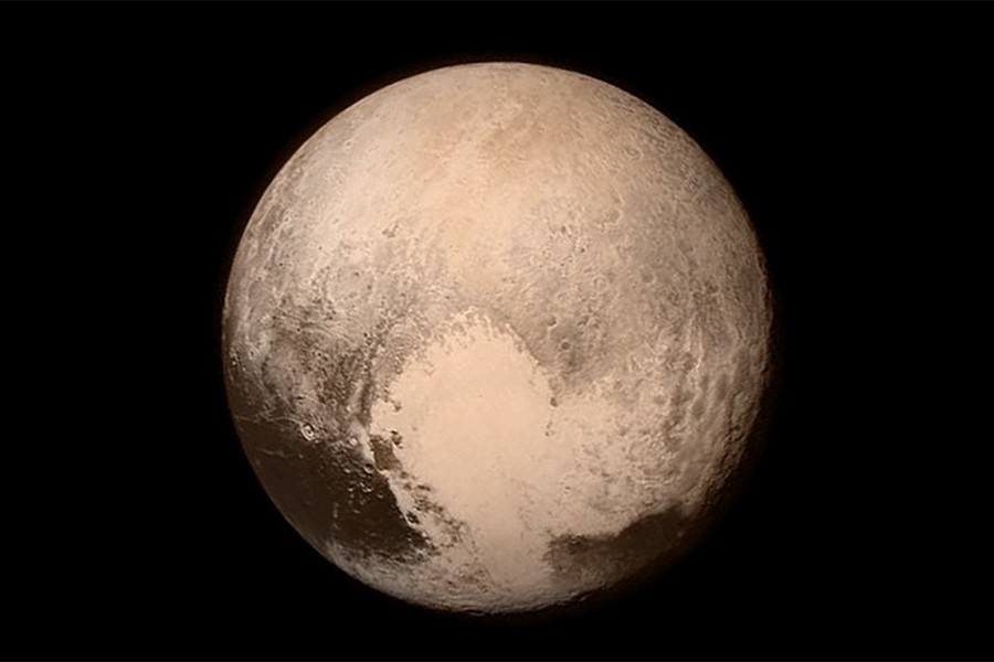 Image depicts Pluto in brown and gray tones