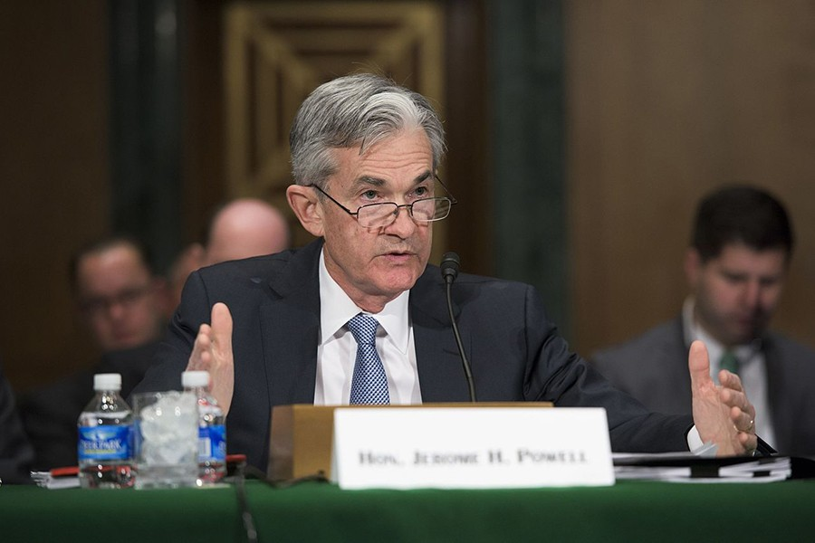 Jerome Powell speaks at a table