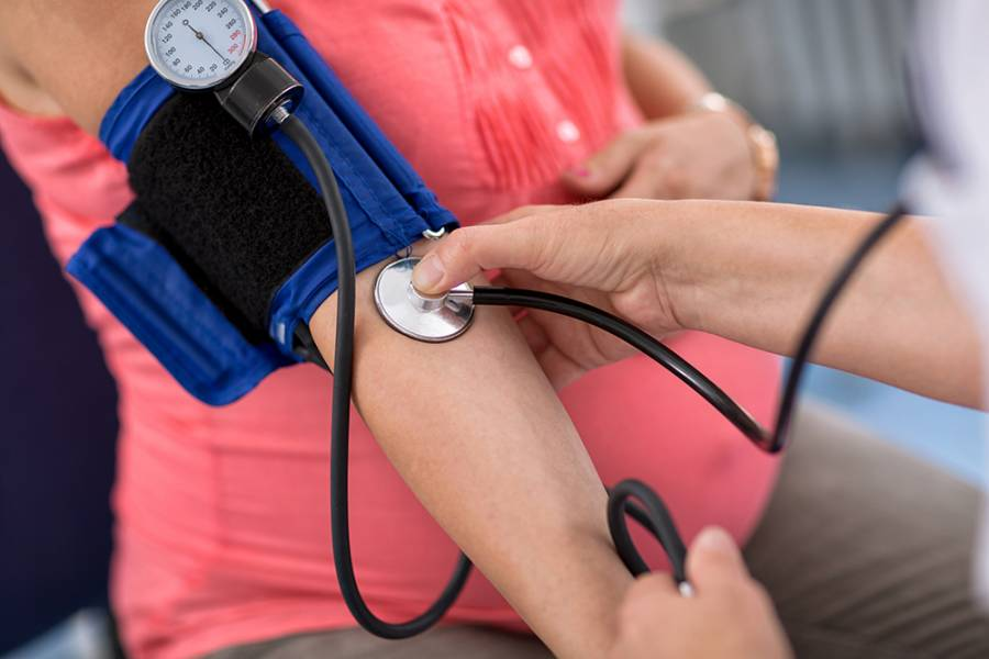 Pregnant woman gets her blood pressure checked