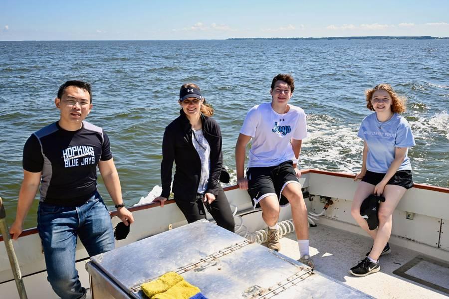 Sarah Preheim with students on the Chesapeake Bay