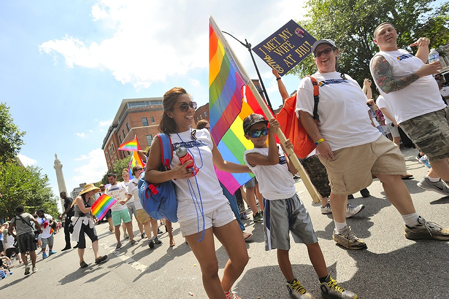 A child carries a rainbow flag in Baltimore's pride parade