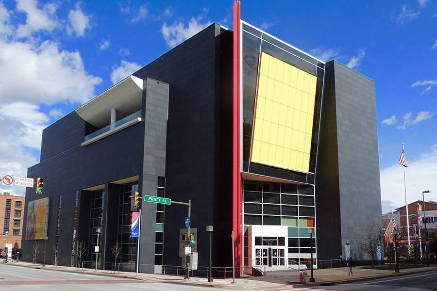 Exterior of modern building with yellow, red facade accents