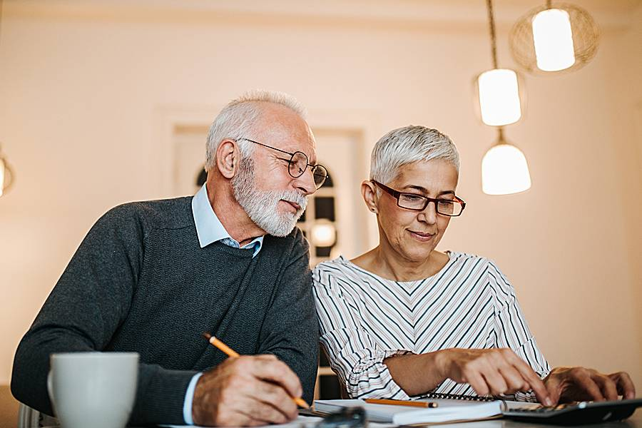 Mature couple at home making a financial plan