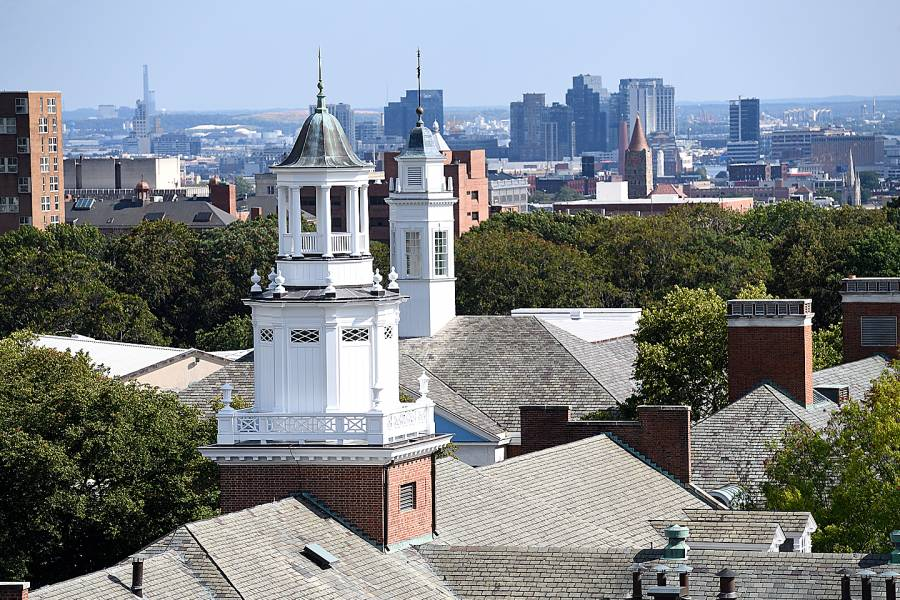 A rooftop view of Homewood campus buildings with the Baltimore skyline in the background