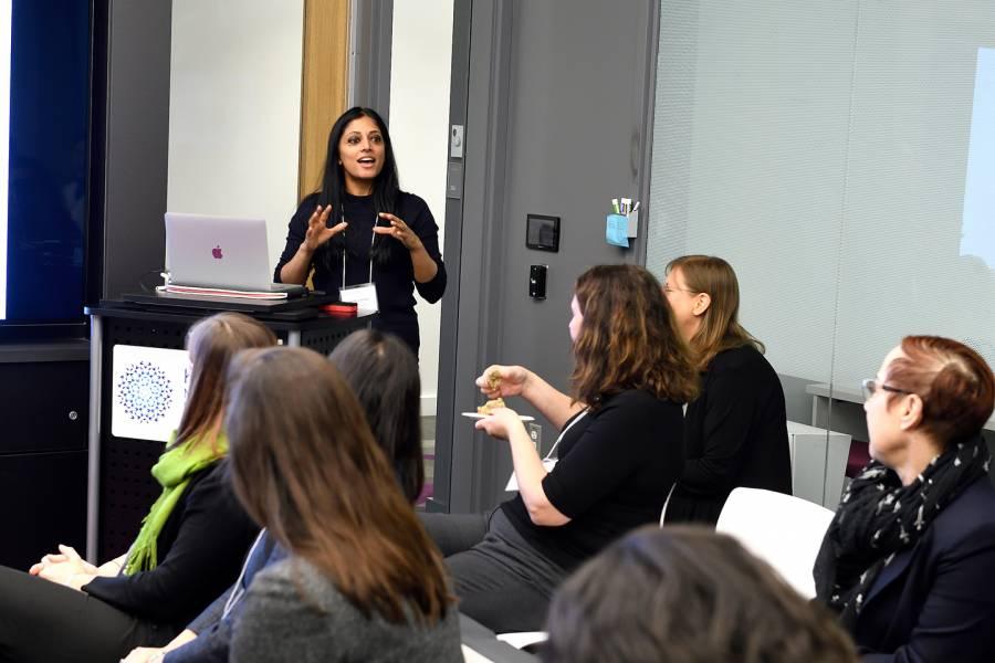 Women speak at a forum