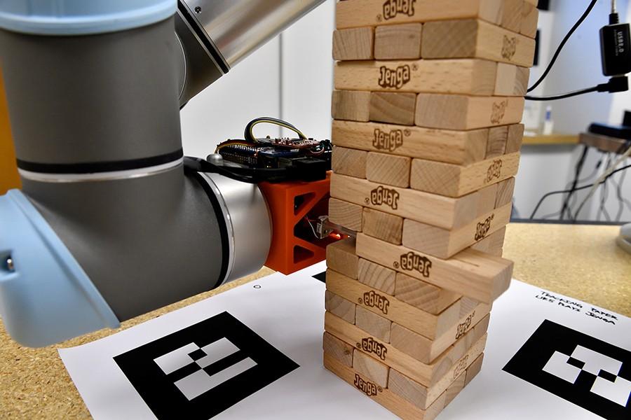 A robot plays Jenga