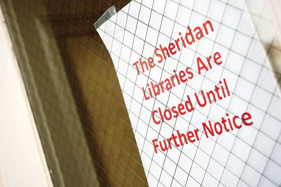 Sign reads Sheridan Libraries Closed Until Further Notice