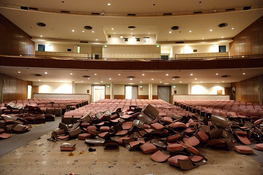 Auditorium chairs are piled up during early stages of the renovation project