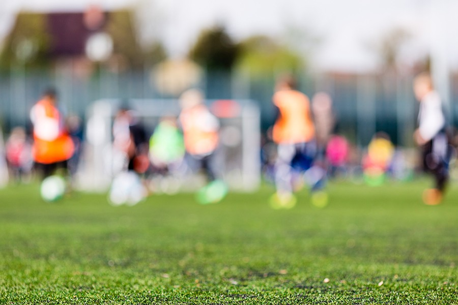 Blurred image of young boys playing soccer