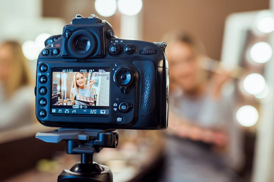 Social media influencer recording a post
