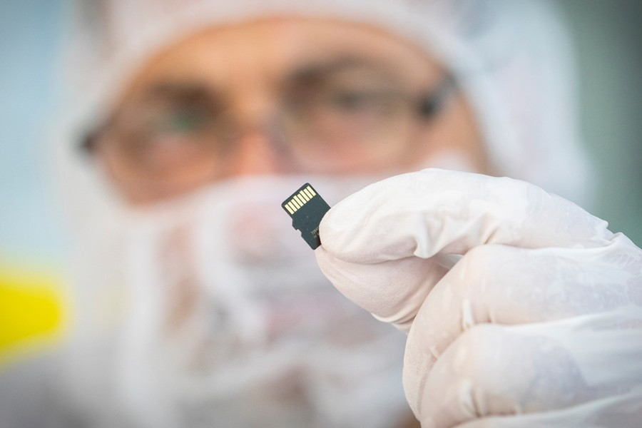 A scientist holds a microchip