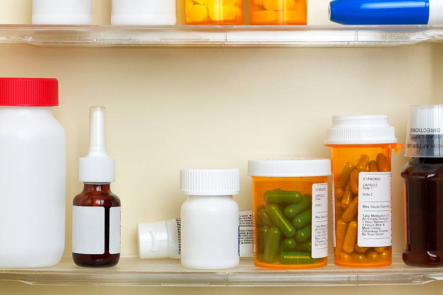 Interior of medicine chest showing prescription drugs and other items