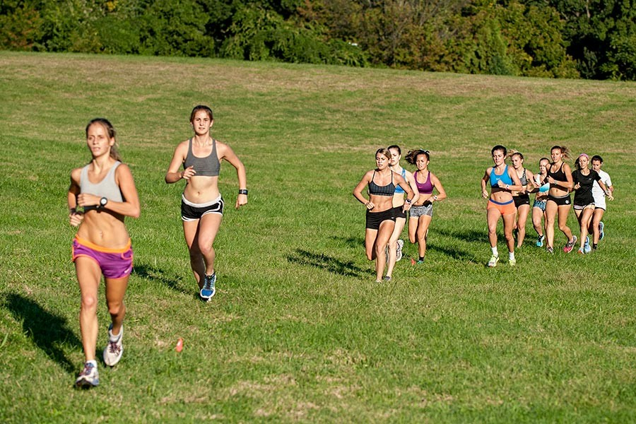 Felicia Koerner leads the pack at a training run at Druid Hill Park.