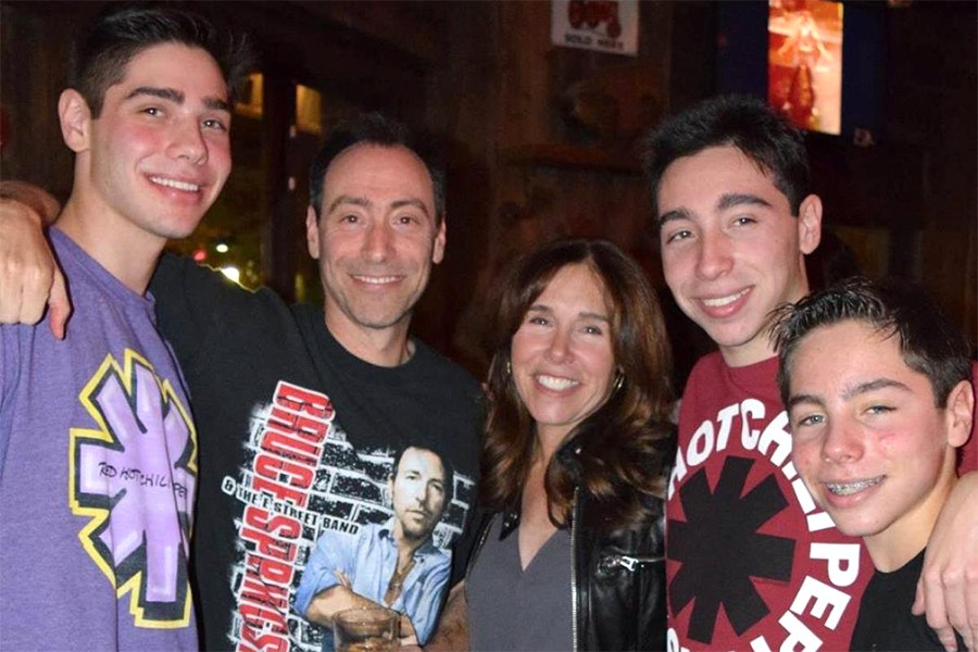 The Steinberg family - parents Bruce and Irene and their three sons, Matthew, Zachary, and William - poses for a photo