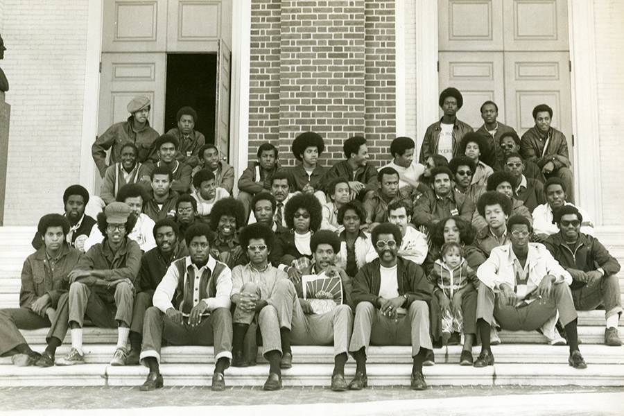 Students seated on the steps of Shriver Hall