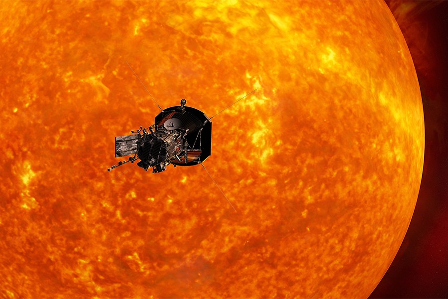 Parker Solar Probe silhouetted against the massive, orange sun