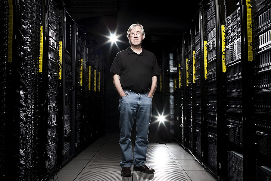 Alex Szalay stands in a dark server room