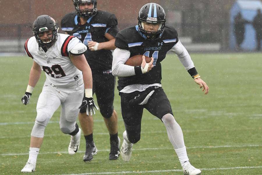 Johns Hopkins QB David Tammaro runs with the football