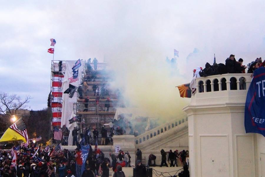 Tear gas engulfs rioters outside the U.S. Capitol building