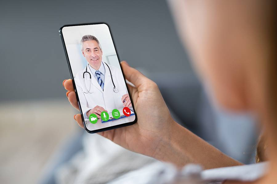 Smartphone screen showing image of a doctor