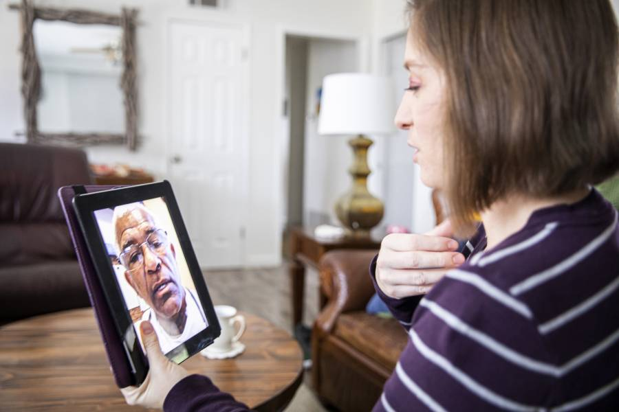 A doctor and patient meet virtually