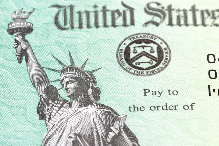 Close-up photograph of a stimulus check with Lady Liberty on it