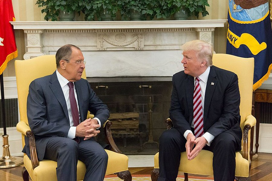 Seated on chairs in the Oval Office, Trump and Lavrov chat