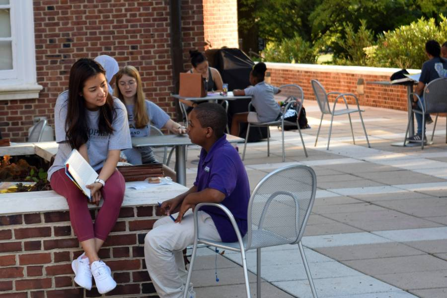 School kids and Johns Hopkins student tutors work together on Homewood campus
