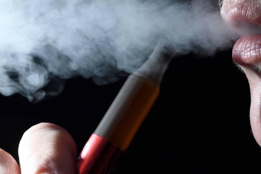An e-cigarette and smoke