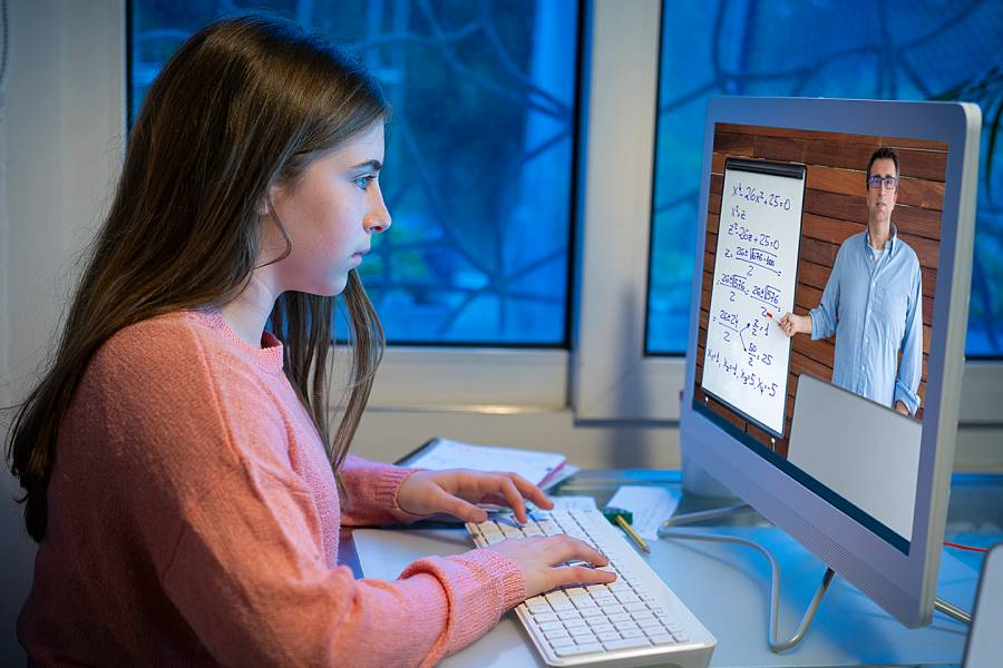 Young girl at computer working with an online tutor