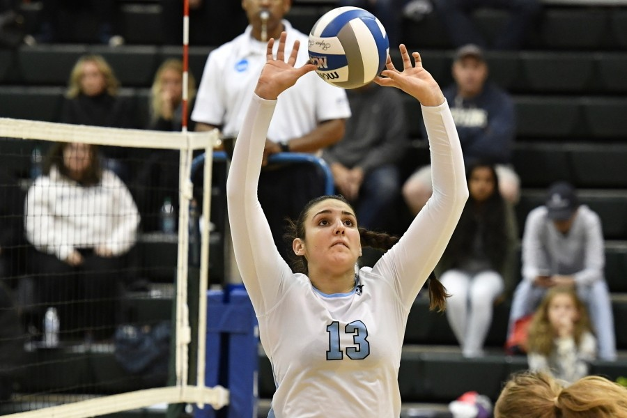 Natalie Aston sets the ball near the net