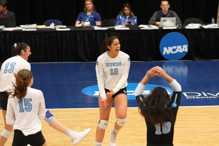 Johns Hopkins volleyball players celebrate a point win