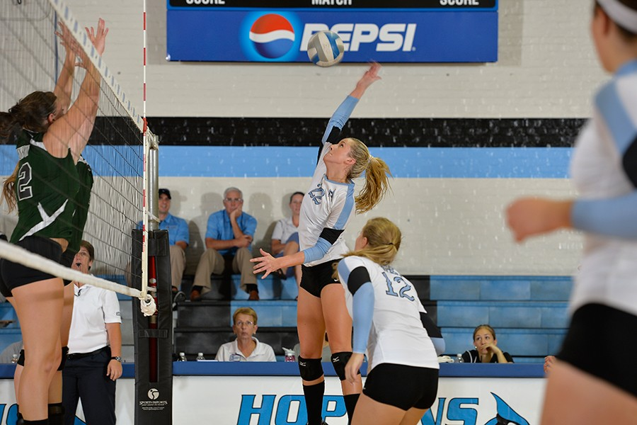 Ali Cox elevates for a hit near the net