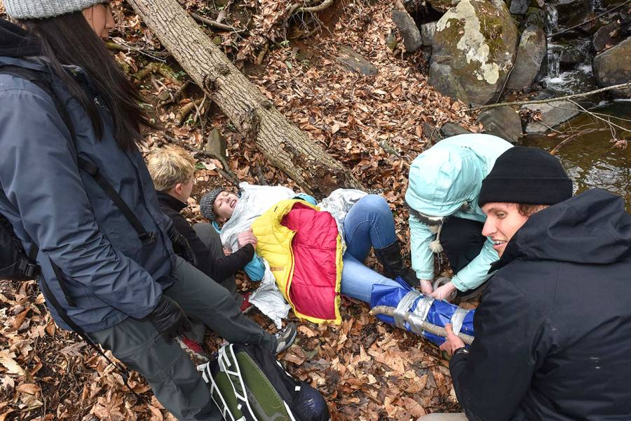 Students tend to a fallen hiker as part of JHU's Austere Medicine/Wilderness Medicine course