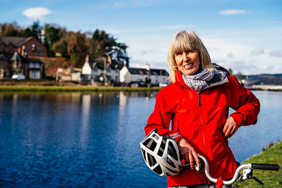 Happy senior woman with bicycle