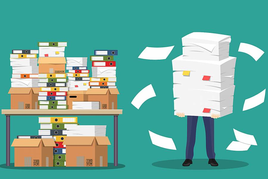 Illustration of desk covered with files and person holding pile of papers