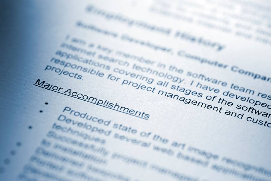 Closeup of a resume listing accomplishments