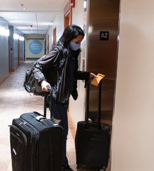 Student moves in to their residence hall