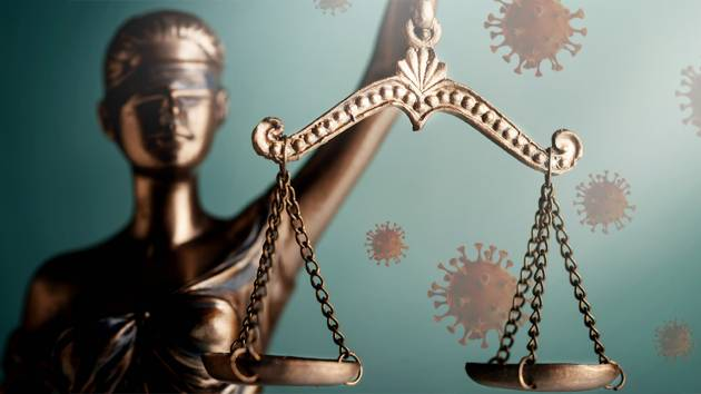 Lady Justice against a background of coronavirus particles