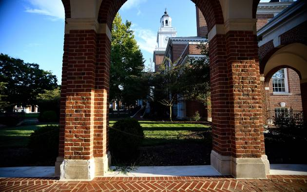 Gilman Hall and brick archways on Johns Hopkins University's Homewood campus