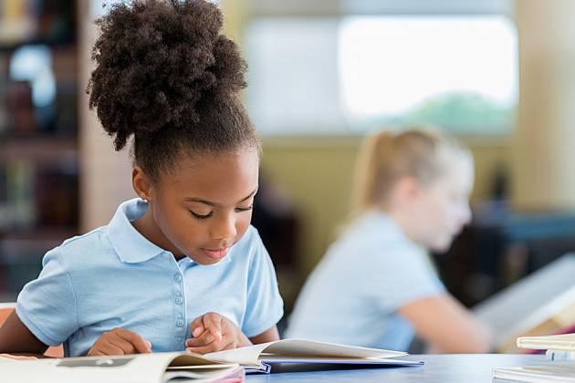 Young girl in a school uniform