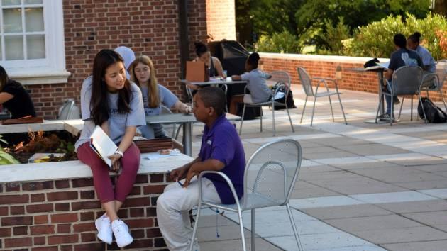 School kids and Johns Hopkins student tutors work together on Homewood campus