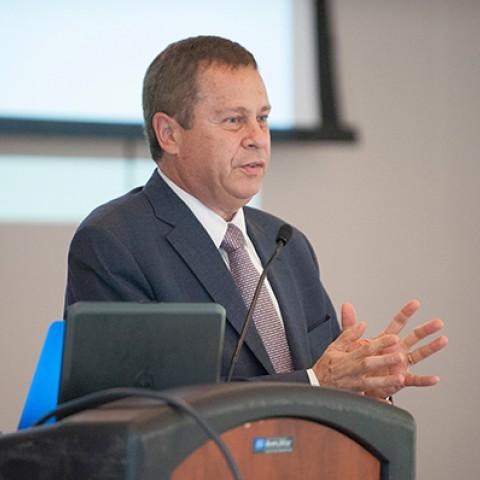 Ed Schlesinger speaks at podium